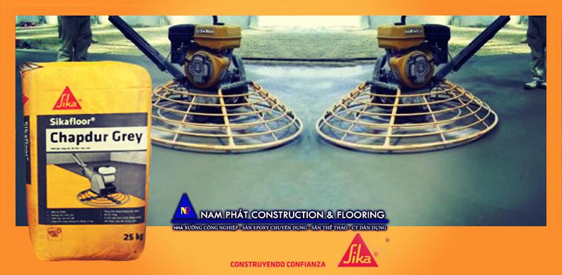 Phủ Sàn Sikafloor Chapdur Grey - Nam Phát CONS nhận thi công  xoa nền bê tông, đánh bóng sàn chuyên nghiệp; cung cấp giải pháp thi công. Hotline: 0966547939 để được hỗ trợ nhanh nhất!